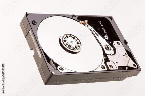 Fotografia  Open computer hard drive disc on white