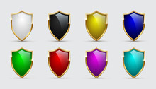 Set Of Color Shields Icons With Golden Frames Isolated On White Background. Vector Design Elements.