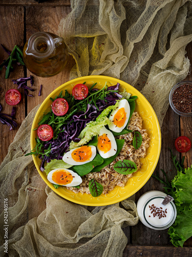 Foto op Plexiglas Japan Diet menu. Healthy lifestyle. Oat porridge, egg and fresh vegetables - tomatoes, spinach, arugula, red cabbage and lettuce on plate. Flat lay. Top view