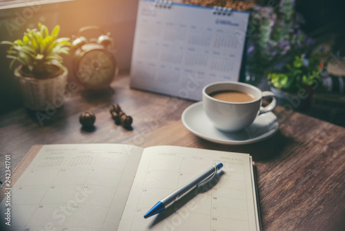 Obraz Appointment schedule Concept. Work from Home, Desktop Calendar,  diary place on office desk. Notebook for Planner to planning timetable,  event agenda,  appointment, organization each  month and year. - fototapety do salonu
