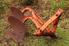 An Old Antique Farm Plough (plow). History Of Farming Concept Image.