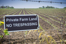"""Private Farm Land No Trespassing"" Sign Posted On A Barbed Wire Fence, California"