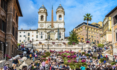 Piazza di Spagna, viewed from the Via Condotti. A lot of people are on the Spanish Steps near church Santissima Trinità dei Monti and Obelisk Sallustiano. Rome.