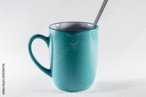 Fotografie, Obraz  cup of coffee with spoon on white background
