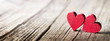Leinwandbild Motiv Two Wooden Hearts On Rustic Table With Sunlight
