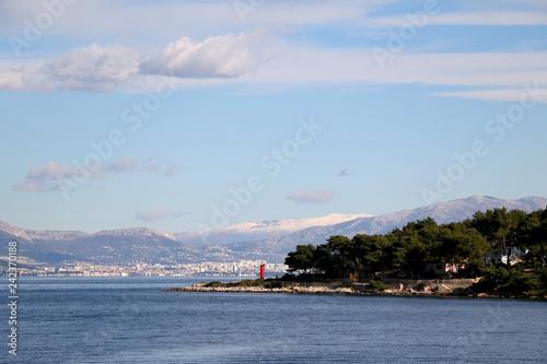 Fotografia Small red solar powered lighthouse on island Solta, Croatia
