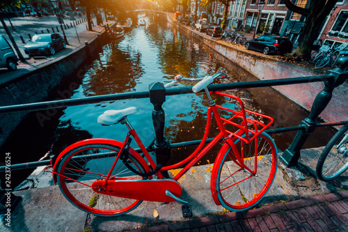 Türaufkleber Fahrrad Symbols of Amsterdam: Red Bicycle parked on a bridge, Netherlands. Travel, romance, vacation, culture concept