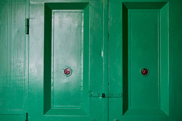 Green doors of an old freight Elevator in an industrial building.Old factory, texture