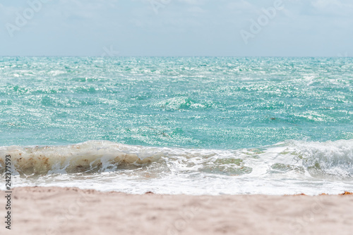 Wave crashing closeup on shore in Sunny Isles Beach, North