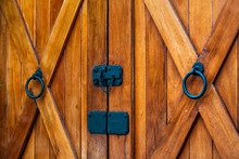 Farm Rustic House Entrance With Brown Orange Color Of Wooden Or Wood Door And Black Handle Abstract Closeup On Charleston, South Carolina With Cross