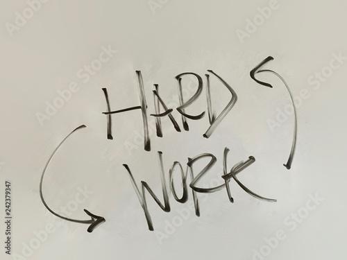 Fotografia  hard work with arrows handwriting