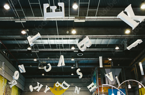 Photo  Valencia, Spain - December 4, 2019: Giant letters hanging from the roof of a fairground