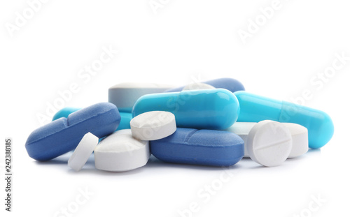Fotografia  Pile of different pills on white background