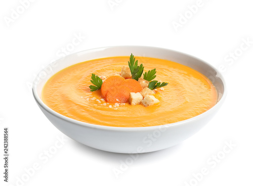 Photo Stands Ready meals Dish with carrot cream soup on white background. Healthy food