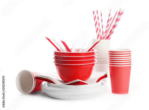 Plastic dishware isolated on white. Picnic table setting