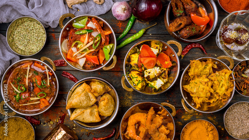 Cadres-photo bureau Magasin alimentation Assorted indian food set on wooden background. Dishes and appetisers of indeed cuisine, rice, lentils, paneer, samosa, spices, masala. Bowls and plates with indian food