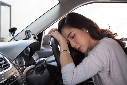 Tired young woman sleep in car, Hard work causes poor health, Sit asleep while t Fototapeta