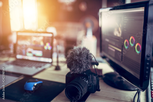 Obraz Freelance desk and laptop for editing footage is job for content upload to internet. - fototapety do salonu