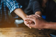 Business partnership of people holding hands together while working teamwork ,Close up of three hand gesture, symbol of common celebration or greeting. Success and teamwork concept,copy space