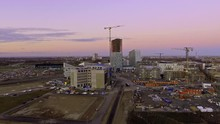 Aerial Shot Going Towards Hyllie Malmoe Sweden That Is Under Construction With Cranes, Hotels And Emporia Business Center In The Sunset In 4k.