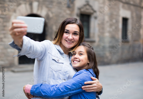 Adult mother and daughter taking photo Fototapeta