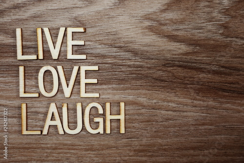 Live Love Laugh text message on wooden background Canvas Print