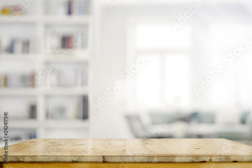 Obraz Empty wooden desk table in living room background - fototapety do salonu