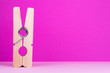canvas print picture - Large clothespin on pink background