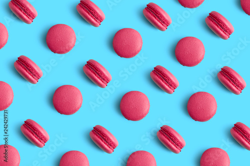 Fotobehang Macarons Macaroons on colored mint background, a pattern of colorful french cookies macarons. Beige, brown french cookies macarons on red background. Gift for Valentine's Day