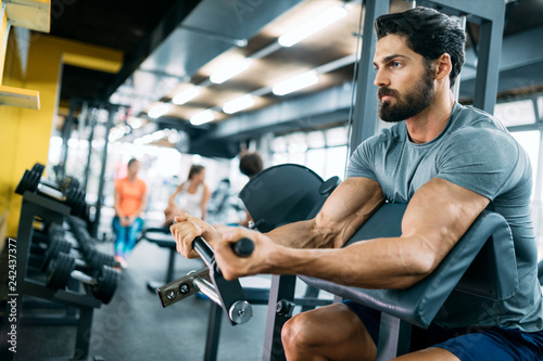 Fotografie, Obraz  Strong ripped man training in modern gym