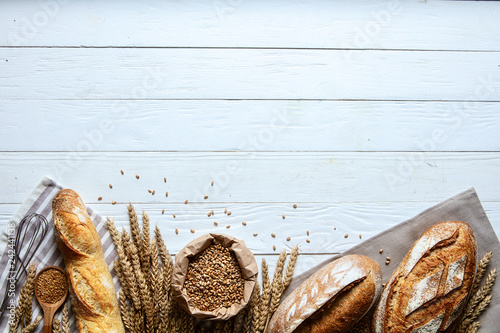 Poster de jardin Boulangerie Still life with bread, flour and spikelets