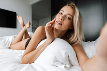 Beautiful Smiling Young Woman Wearing Lingerie Laying