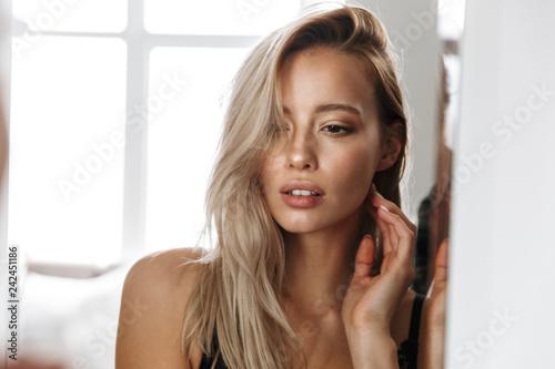 Obraz Beautiful young blonde woman wearing lingerie - fototapety do salonu