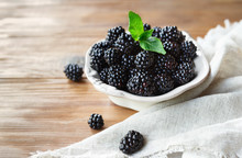 Freah Blackberries In Bowl And Leaves Closeup