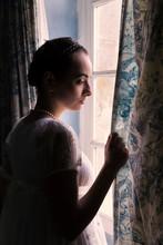 Backlit Woman In Regency Dress