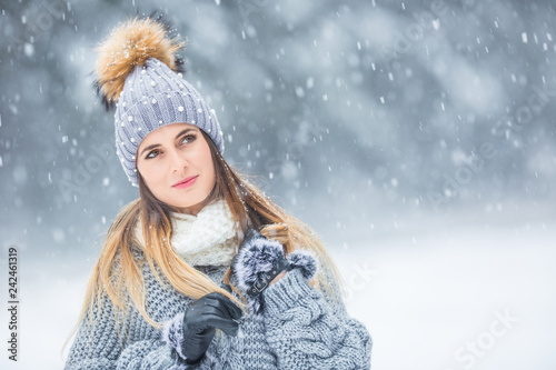 Recess Fitting Fantasy Landscape Portrait of young beautiful woman in winter clothes and strong snowing.