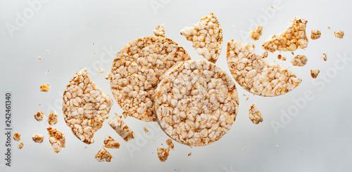 Valokuvatapetti Broken puffed rice bread isolated on white background, diet crispy round rice wa