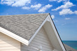 grey roof shingle with blue sky background