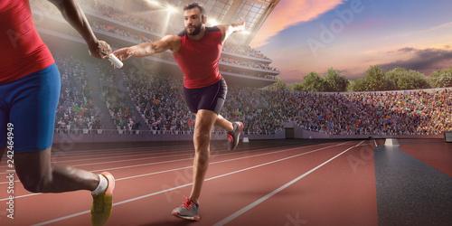 Fotografía  Male athletes sprinting