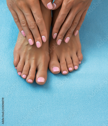 Papiers peints Pedicure Soft female feet and hands with pedicure and manicure