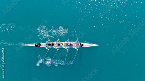 Fotografija Aerial drone bird's eye view of sport canoe operated by team of young men in ope