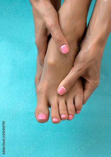 Fotobehang Pedicure Soft female feet and hands with pedicure and manicure