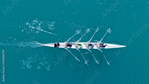 Obraz na plátne Aerial drone bird's eye top view of sport canoe operated by team of young men in