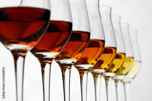 Row of cognac glasses with different stages of aging