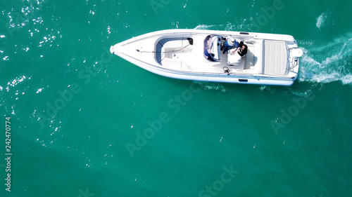 Fototapeta Aerial bird's eye top view photo taken by drone of boat docked in caribbean tropical beach with turquoise - sapphire waters obraz na płótnie