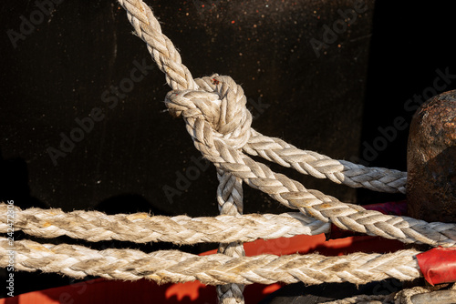 Ropes or hawsers with a mooring bollard - Buy this stock