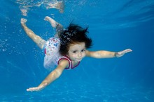 Little Girl Learns To Swim Underwater In The Pool, Ukraine, Europe