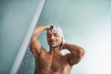 Attractive Young Man With Beautiful Body Washing His Hair While Taking Shower