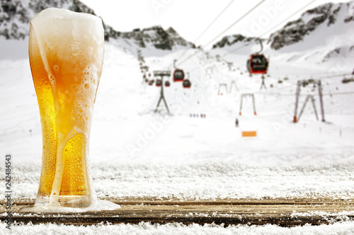 Tuinposter Bier / Cider Winter time in Alps and beer