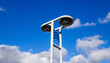 Lamp post under blue sky in sunny day